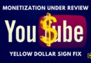 monetize under review youtube yellow dollar sign